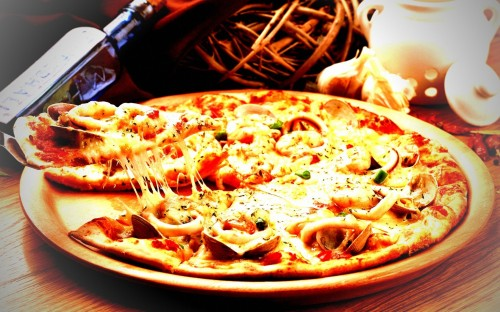 Pizza, while delicious, is very easy to overeat with its fats and high carbs.