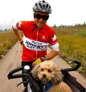 Tony Licata (cq), of Chicago, and his pet poodle Gabi make circuits of the Northery Island bike path Monday, Sept. 21, 2009. (Michael Tercha/Chicago Tribune)