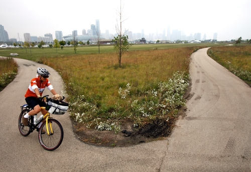 The plus 70 year old blogger riding with his dog on Northerly Island in Chicago.