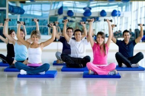 6476491-group-of-people-at-the-gym-exercising-with-free-weights
