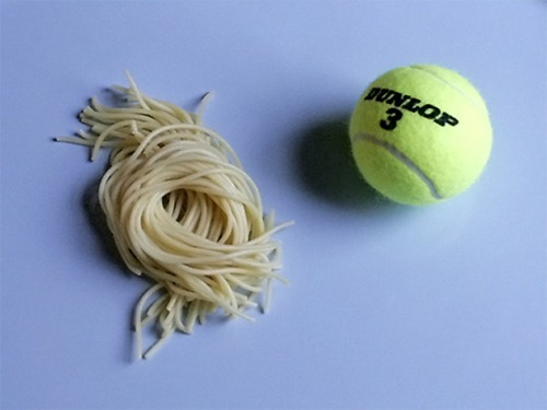 One serving of pasta -200 calories - is about the size of a tennis ball.