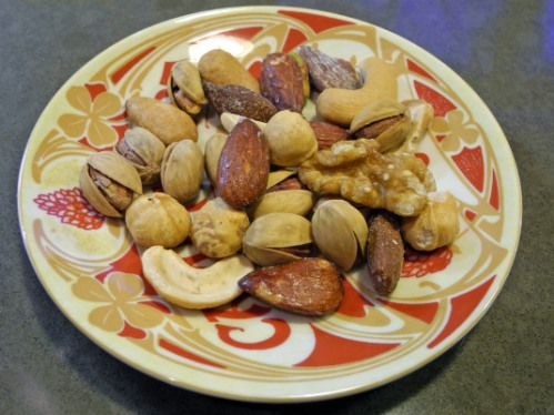 One walnut hiding among other tasty nuts