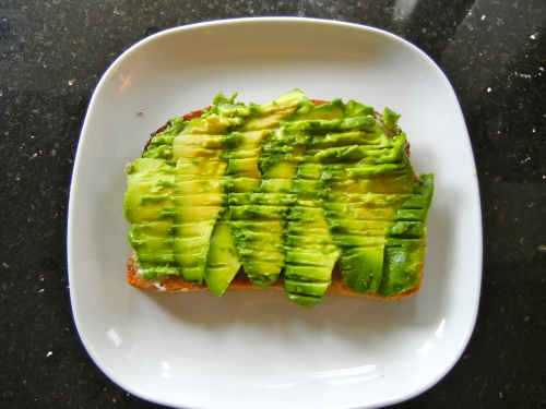 Avocado spread over toast ready for the next step
