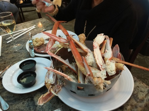 Bucket of crab legs from the buffet.