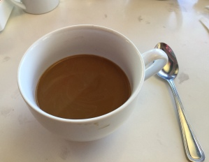 The cup dwarfed the spoon