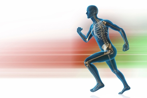 Silhouette of a man and skeleton running on motionblurred background