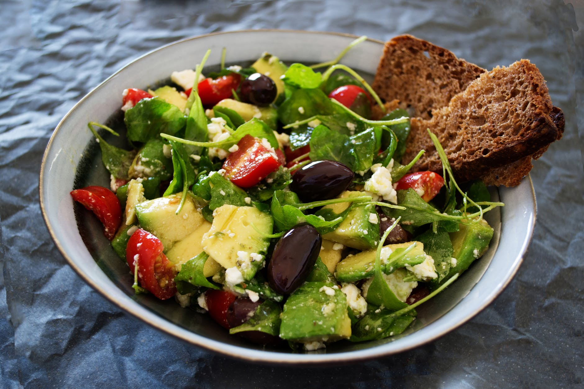 vegetable salad with wheat bread on the side