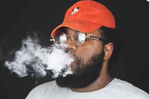 close up photo of a man breathing smoke