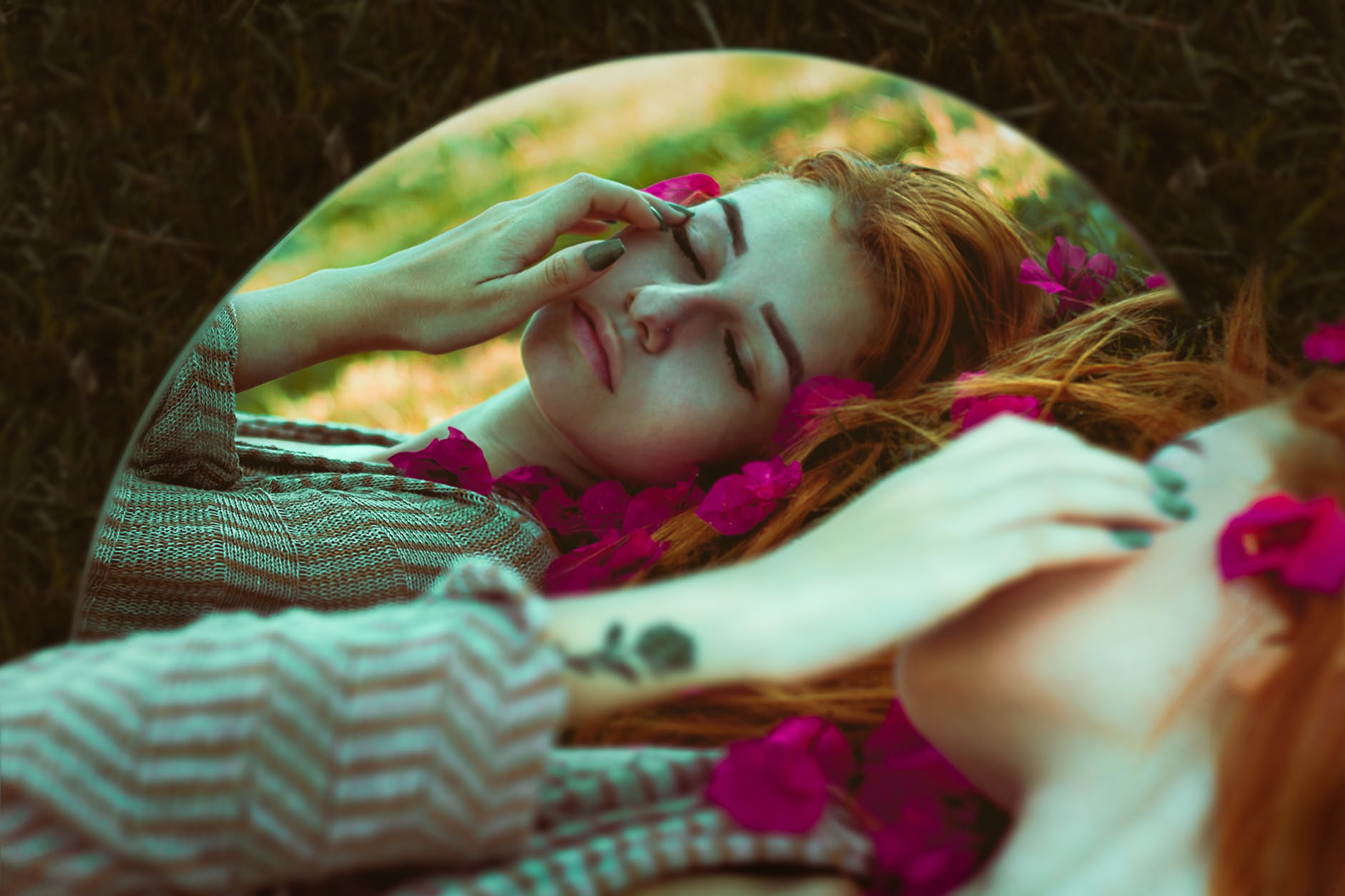 woman lying in brown grass mirror edited photo