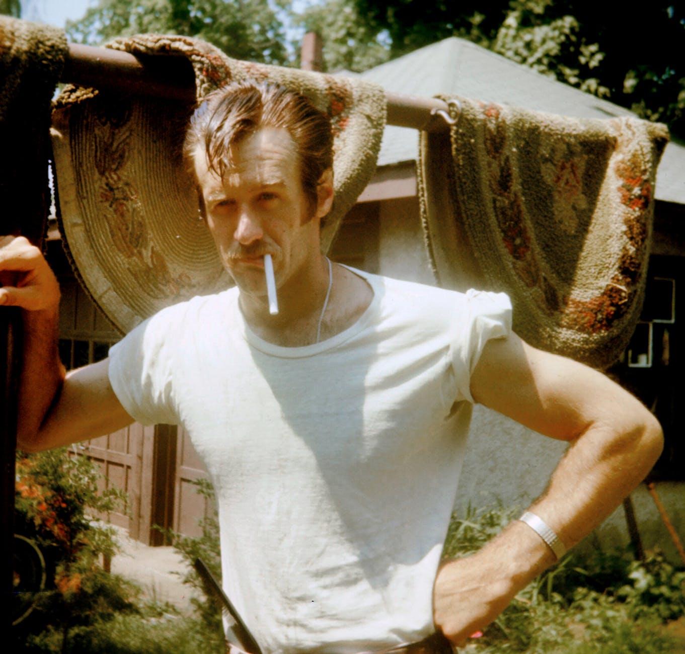 photo of man smoking cigarette