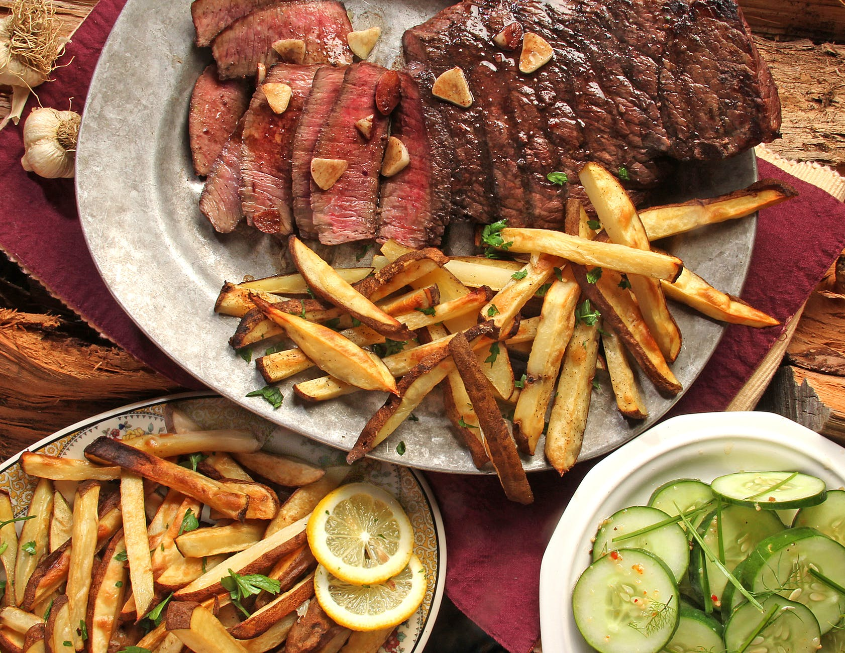 steak and french fries on gray plate