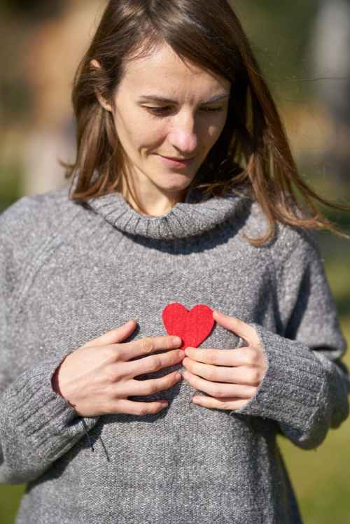 woman holding heart cut out