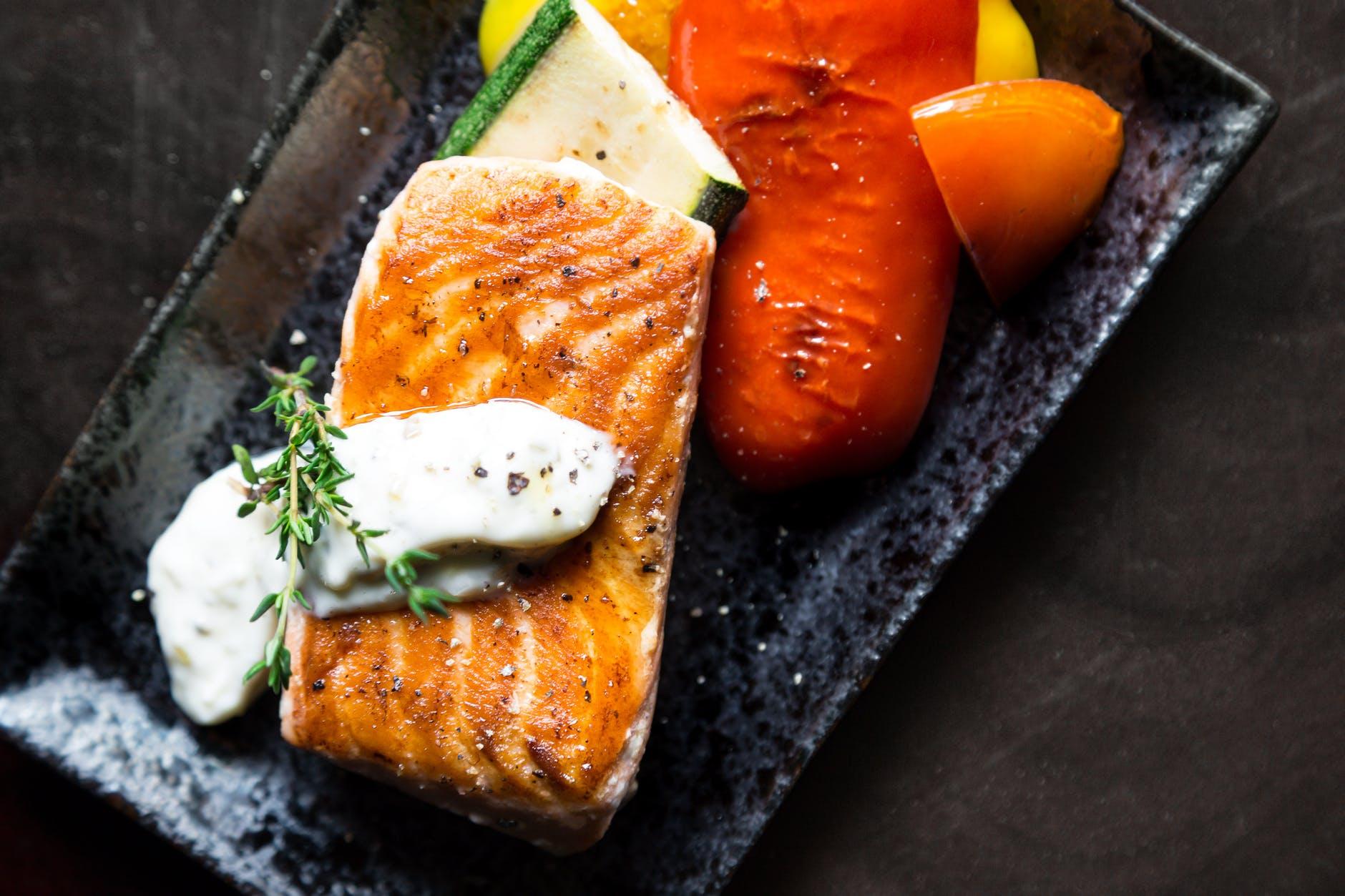 grilled salmon fish on rectangular black ceramic plate